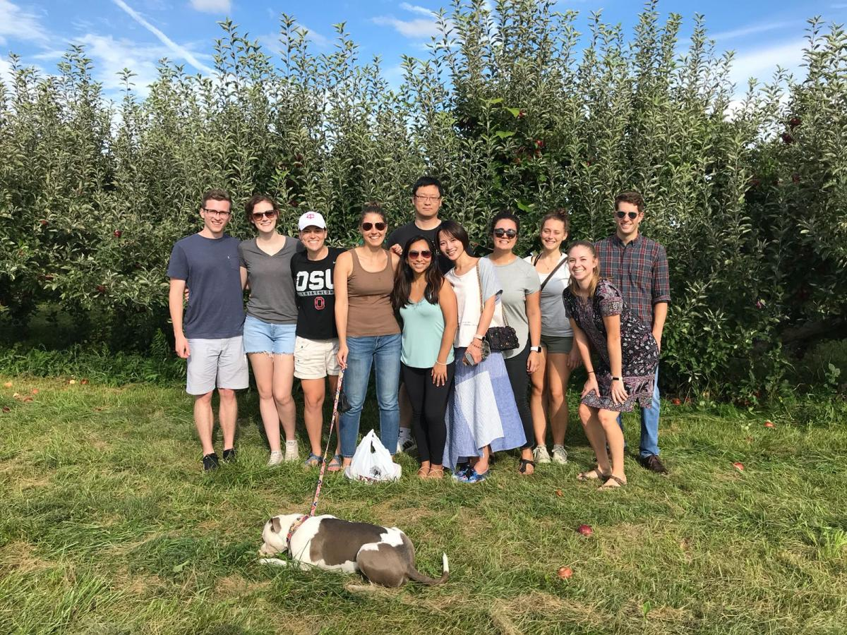 Cooperstone and Kopec labs (and affiliates) having a horticultural adventure apple picking in Fall 2018 at Lynd Farm.  L-to-R: Clark, Emma, Haley, Rachel, Melissa, Rosalie, Jess, Maddy, Jenna, Michael.  Bo in the back and Inu (dog) in the front