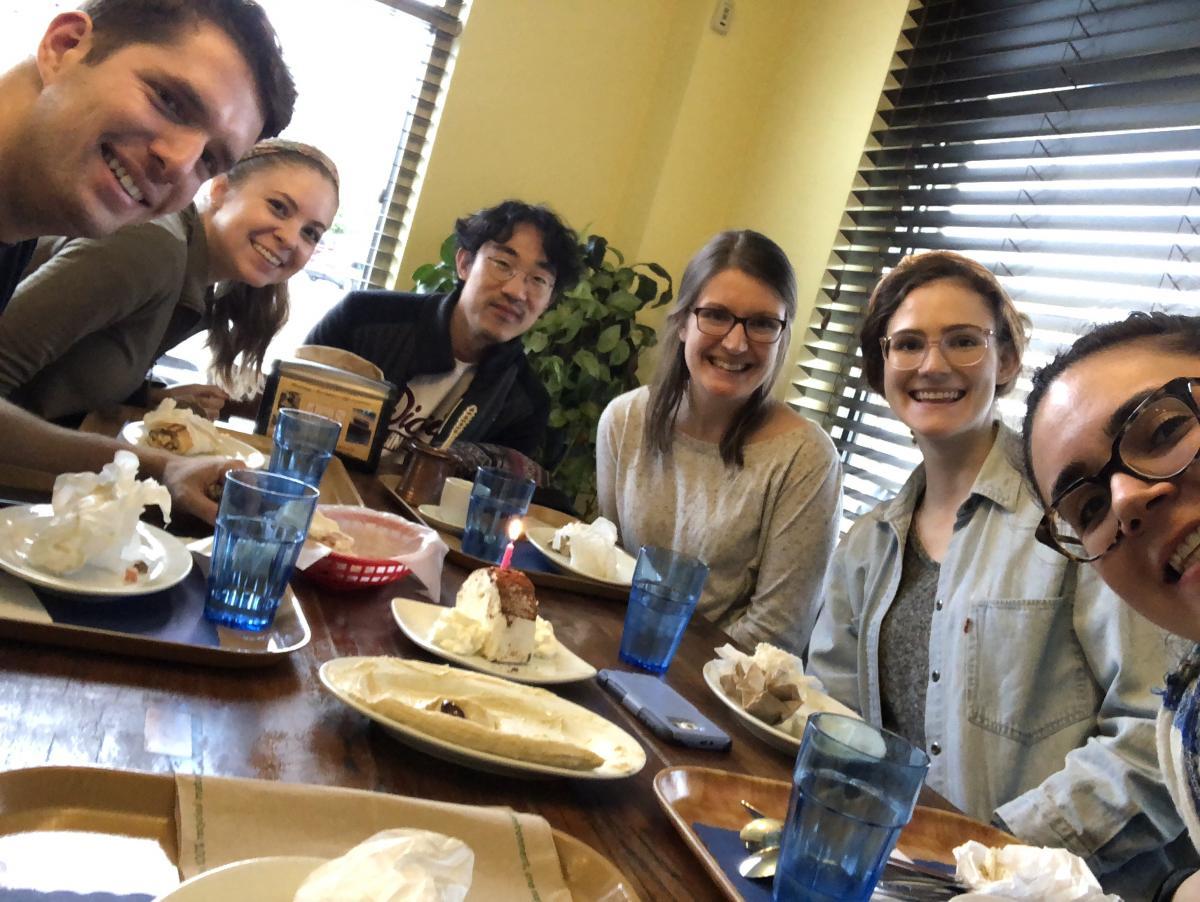 Celebrating Emma's birthday with Lebanese food, Nov 2018, L-to-R: Michael, Jenna, TJ, Mallory, Emma, Jess.  Center, Emma's cake.